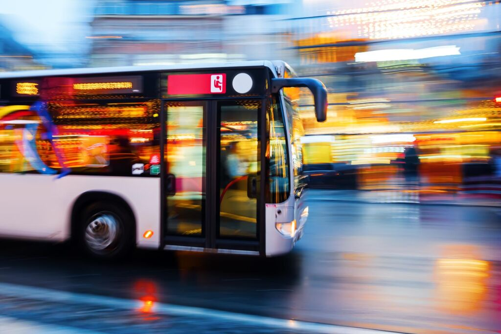 driving bus in the city at night
